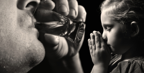 Child Prays Dad Drinks Photo