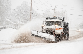 dumptruck-with-plow-plowing-snow-during-northeaster-000015465359_Medium - Copy