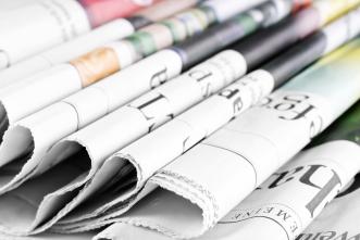 Heap-of-old-newspapers,-selective-focus-000057915480_Medium
